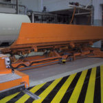 Transfer car from cutter to slat conveyor with roll separation using Roller covers.