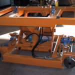 Roll transfer car with lifting mechanism.