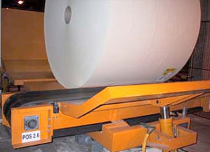 Application with vertical conveyor and turntable on belt conveyor